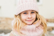 Winter portrait of smile child girl in hat and scarf