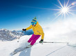 Detaily fotografie Skier skiing downhill in high mountains
