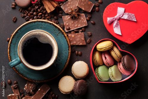Coffee, chocolate and macaroons on old kitchen table © karandaev