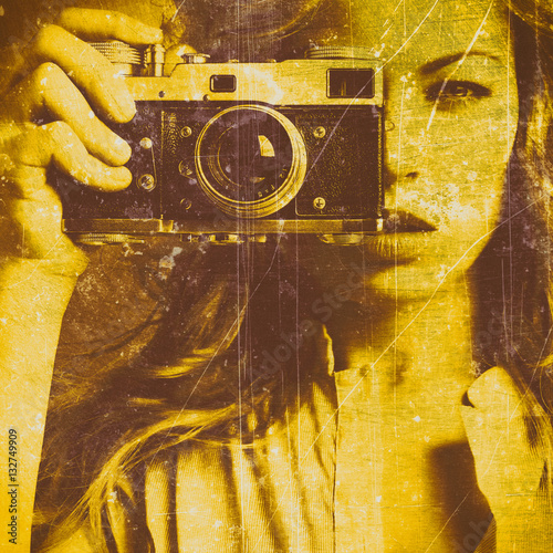 Beautiful woman taking photos with retro film camera. Close up. Old grungy texture. Golden concrete wall © dpaint
