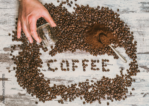 Poster Mixed coffee beans and ground on the table and write coffee.