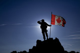 Soldier on top of the mountain with the Canadian flag - 132755793