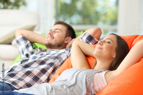 Couple or roommates relaxing at home