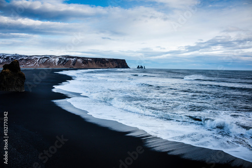 Iceland Vik coast in winter with black volcano sand beach and the shore - 132770342