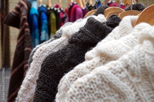 Poster Black and white thick knitted wool winter jumpers and jackets for sale on a marl