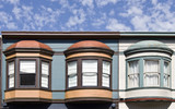 Three San Francisco bay windows with blue sky and clouds. Horizontal.
