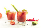 Bloody Mary cocktails with celery and lime