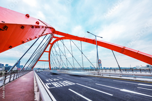 Poster bridge with abstract steel constructions in seoul in cloud sky