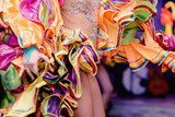 Fototapety Brazilian Carnival. Dancing in bright tropical colors. Toning.Shallow depth of field.
