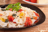 Farfalle Pasta with fresh cherry tomatoes, pesto and red sauce