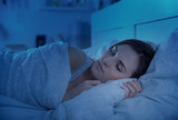 Girl peacefully sleeping in bed at night - 132868928