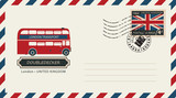 an envelope with a postage stamp with London doubledecker, and the flag of United Kingdom