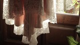 wedding dress on the background of the window