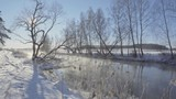 Steam over the water of the river in the winter forest