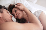 Romantic couple lying together on bed - 132940301