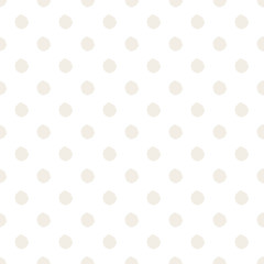 Hand-drawn polka dot seamless pattern. Light beige color. Simple and nice.