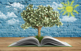 tree growing from book A big open book with tree Reading makes y