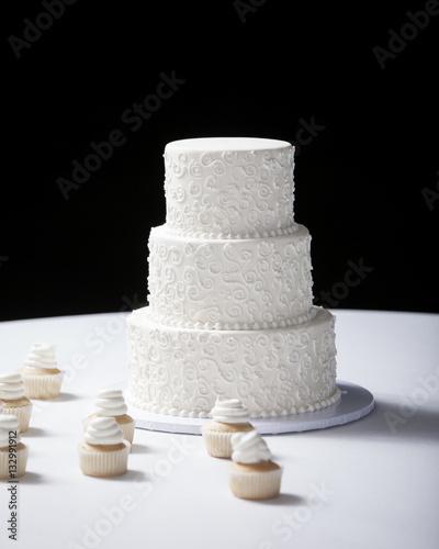Three tiered wedding cake with black background   Buy Photos   AP ...