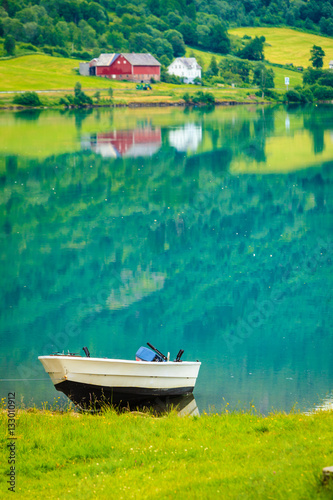 Poster Little boat on water shore, norway fjord