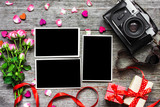 vintage retro camera with blank photo frames and pink roses