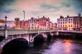 Historic Grattan Bridge over the River Liffey in Dublin Ireland at sunset