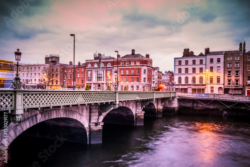 Historic Grattan Bridge over the River Liffey in Dublin Ireland at sunset Poster