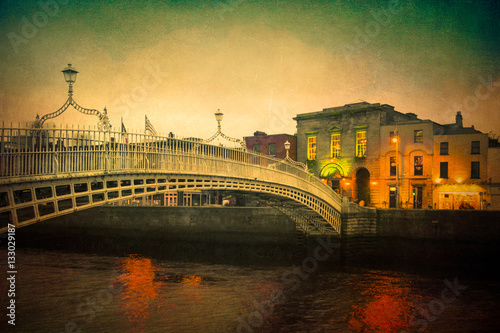 Poster Vintage textured image of Dublin Ireland at Ha'penny bridge over the River Liffe