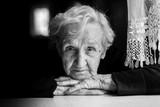 Fototapety Grandma. Closeup black and white portrait of an elderly woman.