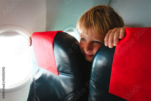 Poster kids travel- cute little boy in plane