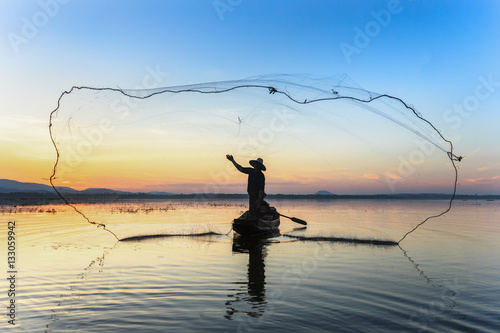 Fishermen fishing in the early morning golden light Poster
