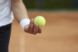 Player is holding a tennis ball.