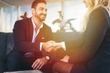 Businessman handshake with businesswoman in office