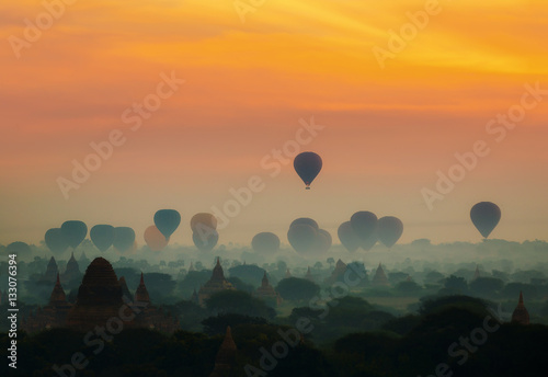 cenic sunrise with many hot air balloons above Bagan in Myanmar Poster