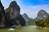 Passenger boats and rafts in the Li River in the Guagxi Region in Chia; Concept for travel in China