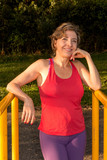 Fit Mature Woman Relaxing After Working Out