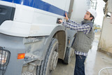 Fototapety Driver opening door of cement transporting truck