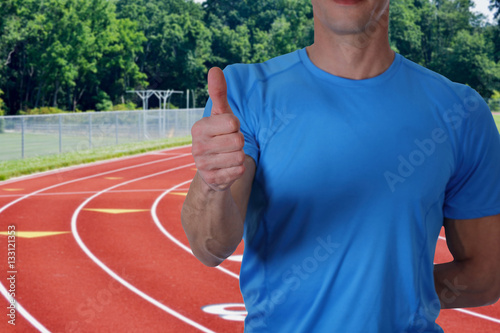 Valokuva Athletic trainer with workout plan close up on tracks