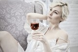 Stylish woman drinking wine