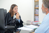 lawyers discussing documents in office - 133128189