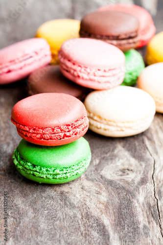 Póster colorful  macarons on rustic wooden backrgound