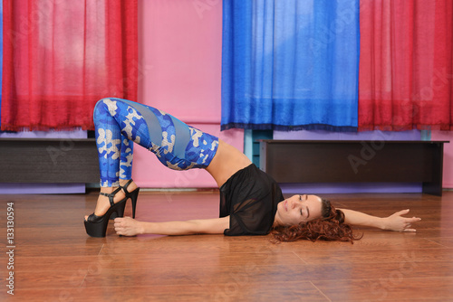 Poster Sexy young woman GO-GO dancer posing lying on the floor