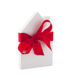 House with red ribbon isolated on white background with clipping path