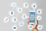 Blockchain and bitcoin concept visualized by mobile phone and grey background