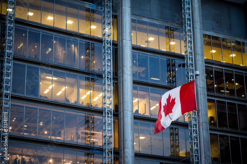 Fotobehang Toronto Canadian flag in front of a business building in Toronto, Ontario, Canada