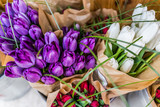 Purple, red and white closeup tulip bouquets wrapped in brown pa