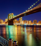 Brooklyn Bridge at dusk viewed from New York City. - 133159112