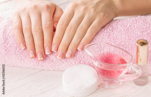 Papiers peints Manicure Woman's hands with French manicure