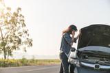 Women spection She opened the hood Broken car on the side See en