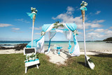 Beautiful white wedding arch for the ceremony on the ocean. - 133182769
