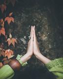 closeup of hands of woman practice yoga